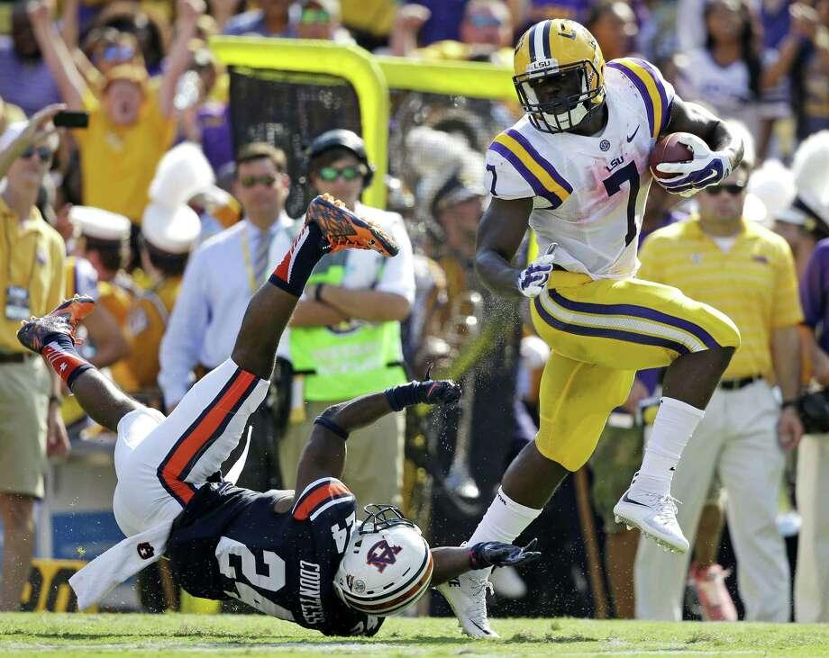 LSU running back Leonard Fournette eludes an Auburn defender on Saturday. Photo: The Associated Press   / AP
