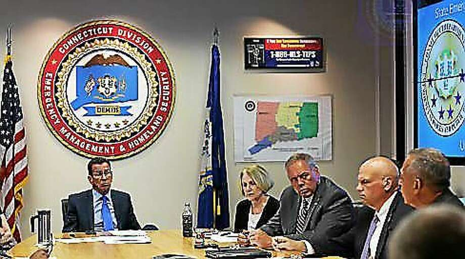 Hartford Mayor Pedro Segarra makes his pitch to  Gov. Dannel Malloy during a meeting Monday at the Emergency Operations Center. Photo: Courtesy CTNJ