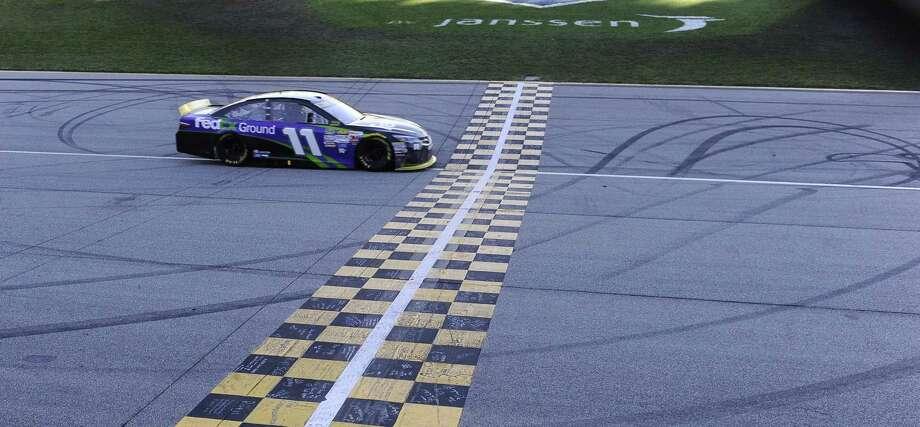 Denny Hamlin won the NASCAR Sprint Cup Series race at Chicagoland Speedway on Sunday. Photo: Matt Marton — The Associated Press   / FR170980AP