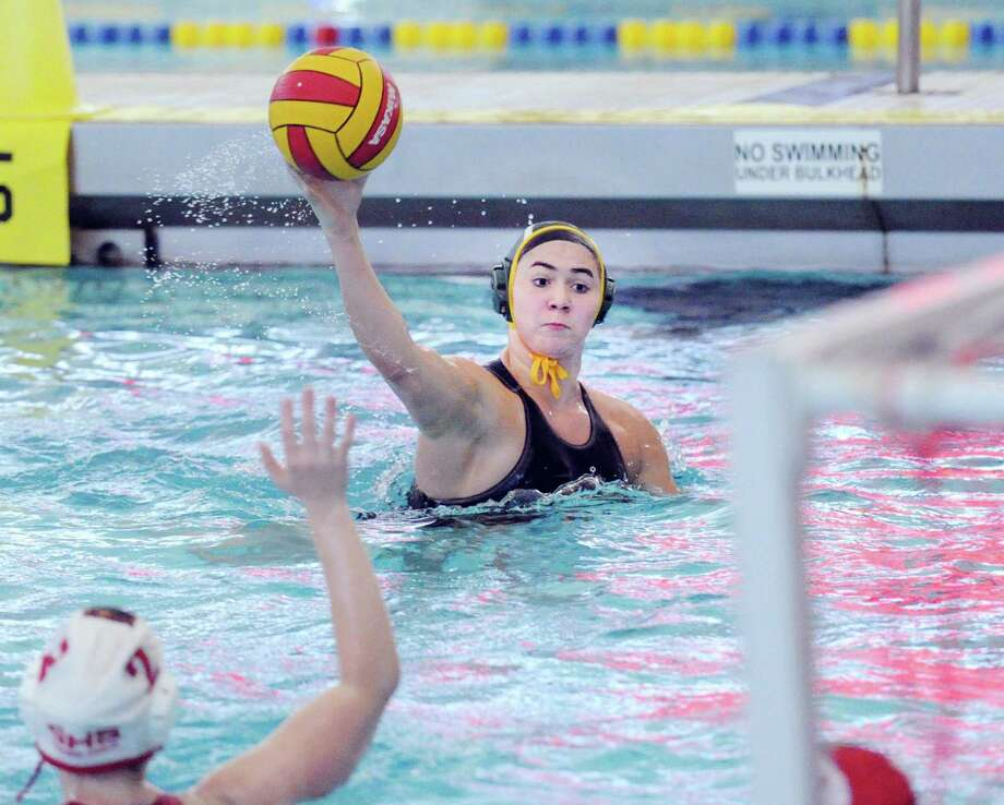 Greenwich Academy's Kayla Yelensky shoots and scores during the girls high school water polo match between Greenwich Academy and Greenwich High School at the YMCA of Greenwich, Conn., Tuesday, April 4, 2017. GA won the match beating GHS, 13-12. Photo: Bob Luckey Jr. / Hearst Connecticut Media / Greenwich Time