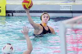 Greenwich Academy's Kayla Yelensky shoots and scores during the girls high school water polo match between Greenwich Academy and Greenwich High School at the YMCA of Greenwich, Conn., Tuesday, April 4, 2017. GA won the match beating GHS, 13-12.