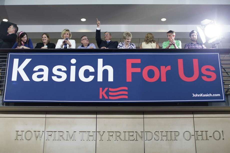 Supporters wait for Ohio Gov. John Kasich to announce he is running for the 2016 Republican partyís nomination for president during a campaign rally at Ohio State University, Tuesday, July 21, 2015, in Columbus, Ohio. Kasich, a two-term governor and former congressman, has little name recognition in the crowded GOP field, but he is already airing television ads in New Hampshire where he is heading immediately after making his run official. (AP Photo/John Minchillo) Photo: AP / AP