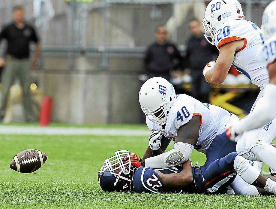 UConn running back Arkeel Newsome of Ansonia hopes to put his freshman-season fumbling issues behind him. Photo: Jessica Hill — The Associated Press File Photo   / FR125654 AP