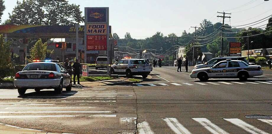 New Haven police responded to a shooting at a Sunoco station on Foxon Boulevard Monday, July 20, 2015. Photo: (Wes Duplantier/New Haven Register)