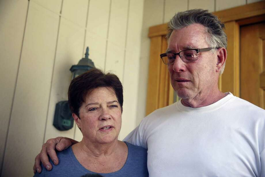 In this file photo, Liz Sullivan, left, and Jim Steinle, right, parents of Kathryn Steinle, talk to members of the media outside their home in Pleasanton, Calif. Kate Steinle was walking along a San Francisco pier July 1 when she was killed by a gun allegedly fired by Juan Francisco Lopez-Sanchez, who is in the country illegally. Photo: Lea Suzuki/San Francisco Chronicle Via AP, File / San Francisco Chronicle