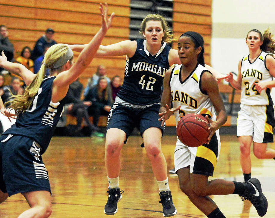 Hand's Gabby Martin takes the ball to the basket while Morgan's Sami Ashton and Riley Smith defend. Photo: Dave Phillips — GameTime CT