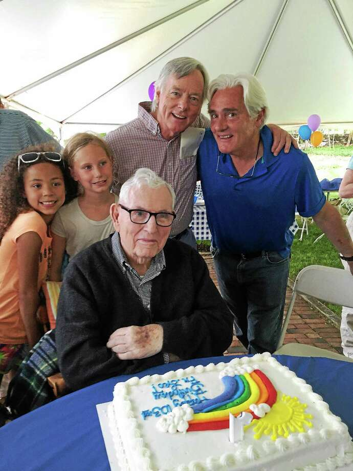 Archbishop Peter Leo Gerety, the world's oldest living Catholic bishop, celebrates at his 103rd birthday party with great-grand-nieces Charlotte Murphy, left, and Stori Small, and nephews Peter L. Gerety III, left, and Miles Gerety, both attorneys in Bridgeport. Photo: Contributed Photo