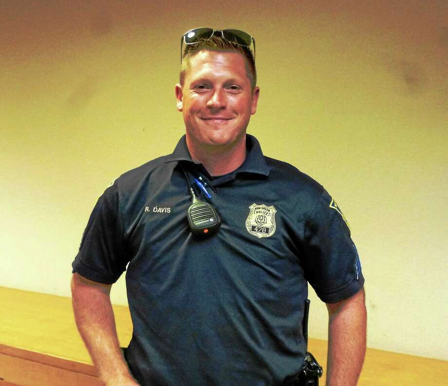 (Ryan Flynn - New haven Register)  Sgt. Roy Davis has been with the New Haven Police for eight years. He took over the Downtown district manager position on Sept. 7.  He is shown here at a management team meeting. Photo: Journal Register Co.