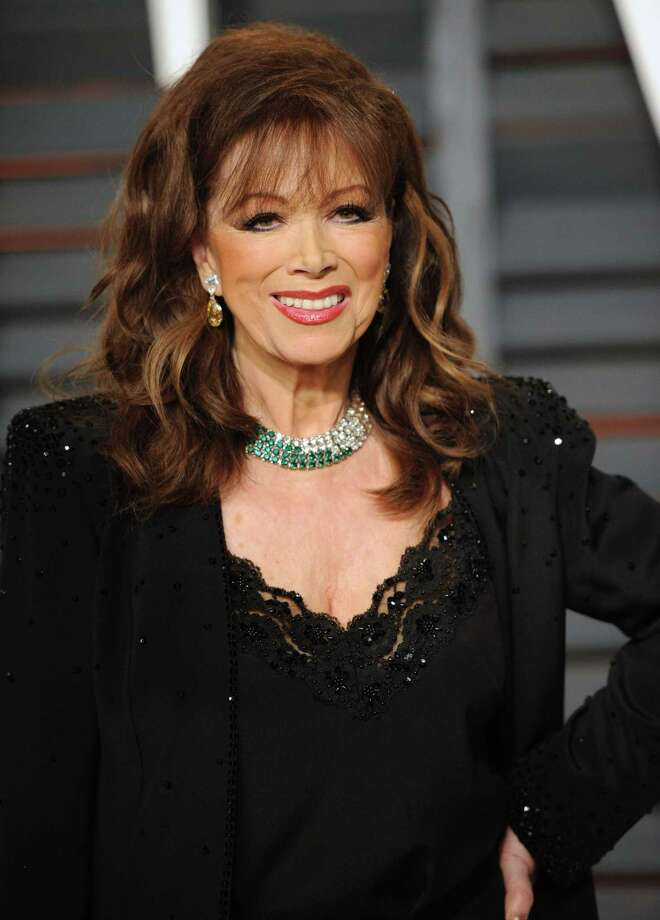 In this Feb. 22, 2015 photo, author Jackie Collins arrives at the 2015 Vanity Fair Oscar Party in Beverly Hills, Calif. Collins died of breast cancer in Los Angeles on Sept. 19, 2015 at age 77. Photo: Photo By Evan Agostini/Invision/AP, FIle   / Invision