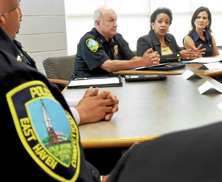 Flanked by East Haven Police Chief Brent Larrabee, left, and U.S. Attorney for Connecticut Deirdre M. Daly, right, U.S. Attorney General Loretta E. Lynch, center, speaks during a community policing forum at East Haven High School Tuesday. Photo: Peter Hvizdak — New Haven Register   / ©2015 Peter Hvizdak