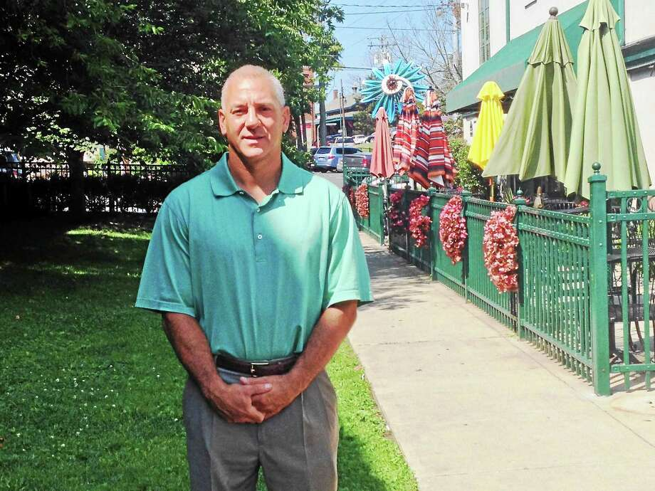 Richard Ciardiello, owner of Eli's Tavern on Daniel Street, is fighting to get a slice of a city park for patio seating — the green area on left — so his customers can enjoy outdoor seating like those at nearby Cafe Atlantique, at right. Photo: Pam McLoughlin — New Haven Register