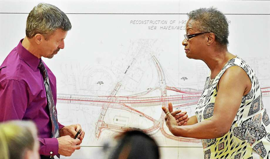 City Point resident Thomasine Shaw voices her concerns to Jim Pelletier, state Department of Transportation supervising engineer, regarding the reconstruction of Interstate 95 over West River in New Haven and West Haven, at the Parish Recital Hall on Kimberly Avenue Tuesday. Photo: Catherine Avalone — New Haven Register   / Catherine Avalone/New Haven Register
