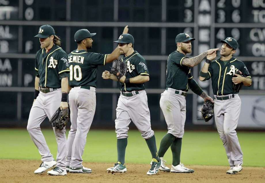 The Oakland Athletics celebrate their 4-3 win over the Astros on Friday in Houston. Photo: Pat Sullivan — The Associated Press   / AP