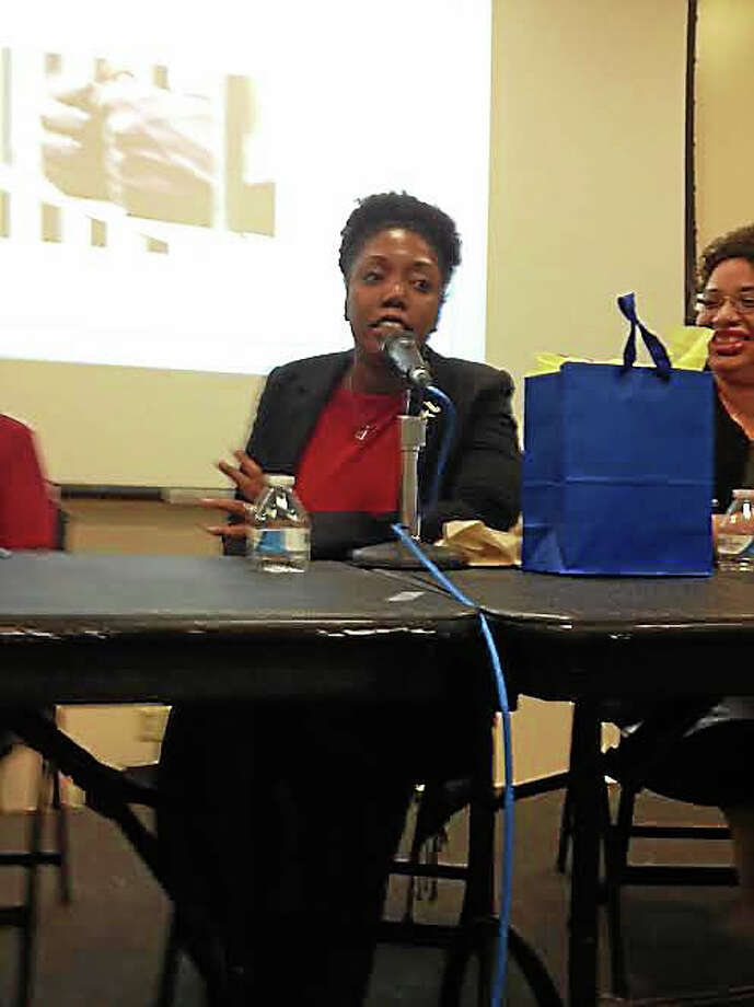 University of New Haven assistant professor Danielle Cooper speaks at race forum Wednesday in West Haven. Photo: Randall Beach — New Haven Register