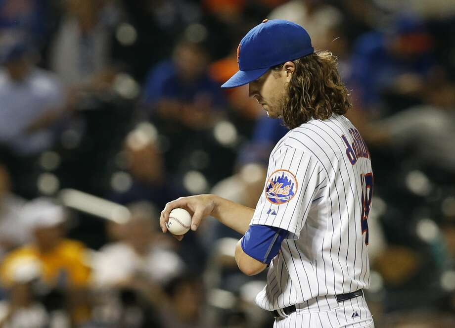 Mets starter Jacob deGrom reacts after allowing three runs in the fourth inning Tuesday against the Miami Marlins in New York. Photo: Kathy Willens — The Associated Press   / AP
