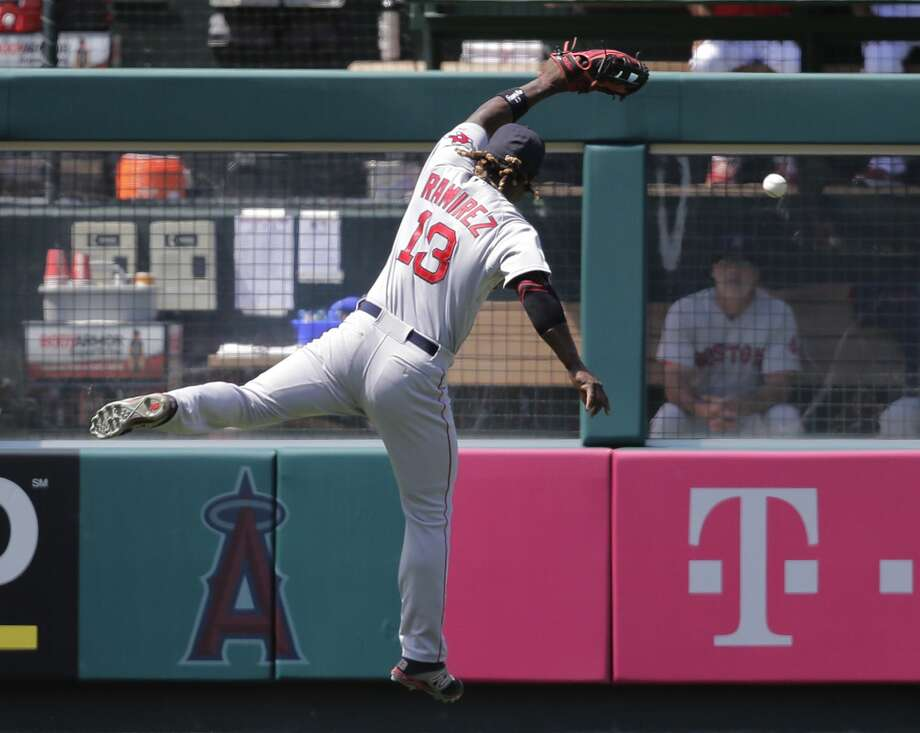 Hanley Ramirez is unable to catch a RBI double hit by the Angels' Daniel Robertson during the second inning Monday. Photo: Jae C. Hong — The Associated Press   / AP