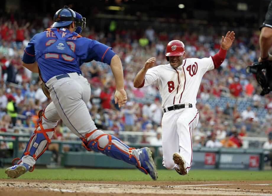 The Nationals' Danny Espinosa (8) scores on a single by Yunel Escobar in the first inning on Monday. Photo: Alex Brandon — The Associated Press   / AP
