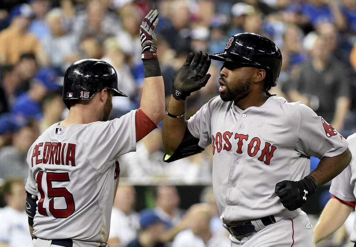 Jackie Bradley, right, celebrates his two-run home run with teammate Dustin Pedroia during the ninth inning on Saturday.