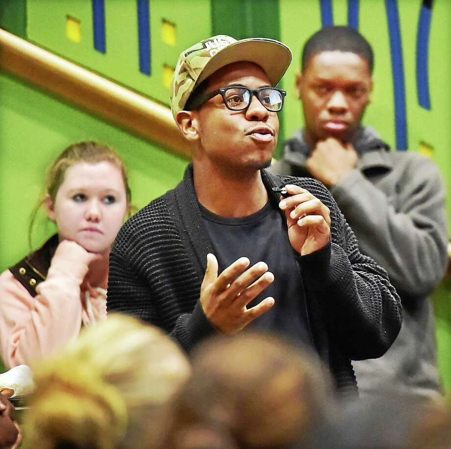 "Quinnipiac University senior Isaiah Lee talks about his experiences regarding racism during ""A Place at the Table,"" a university-wide conversation Tuesday night at which students and staff discussed racism, diversity, inclusiveness and freedom of expression that is taking place on many college campuses. Photo: Catherine Avalone — New Haven Register      / New Haven RegisterThe Middletown Press"
