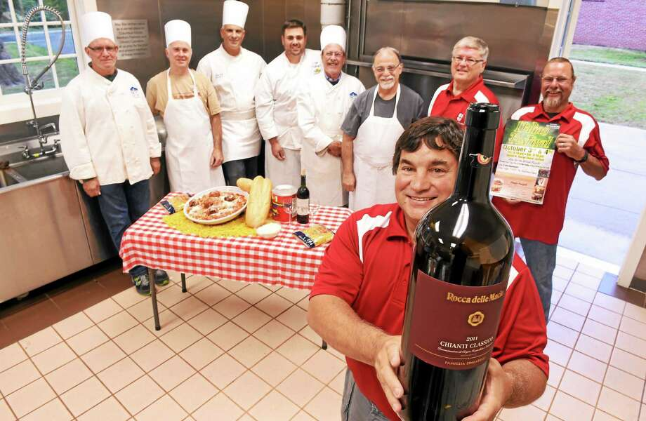 In the kitchen preparing for last year's Italian Festival are St. George's Church Men's Group members Jim Mancini, front, and at rear, from left, Walter Heinemann, Don Smith, Jeff Trombetta, Bob Mongillo, Mike MacDonald, Tony Sicignano, Bill White and Mike Weady. Photo: Peter Hvizdak — New Haven Register FILE PHOTO   / ©2014 Peter Hvizdak