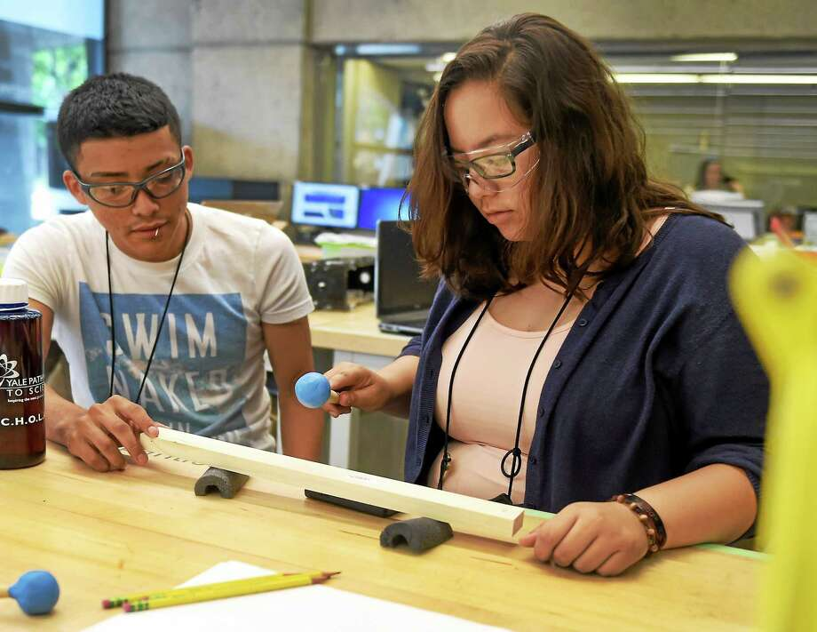 Laurent Briones of New Haven, 16, left, and Nina Filippone of Ansonia, 17, right, start building a xylophone together  at the Yale Center for Engineering Innovations & Design, right,  using engineering methodology of calculating music tone frequencies during the Yale Pathways to Science Summer Scholars Program at the CEID.  The New Haven area high school students will build xylophones using the methodology. Photo: Peter Hvizdak--New Haven Register   / ©2015 Peter Hvizdak