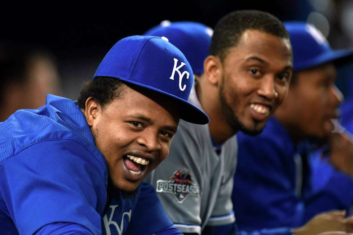 Kansas City Royals' Edinson Volquez, left, and teammates watch from the dugout during the seventh inning in Game 4 of baseball's American League Championship Series on Tuesday, Oct. 20, 2015, in Toronto. (Frank Gunn/The Canadian Press via AP) MANDATORY CREDIT