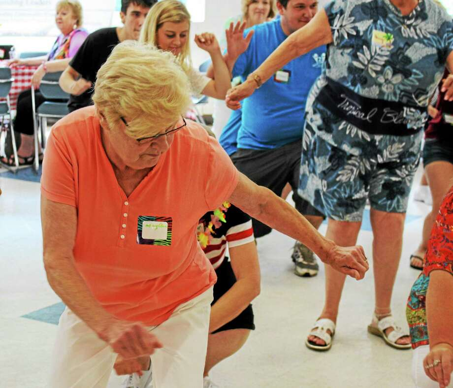 "Mary Ann Brozak dances up a storm during the ""beach bash"" at Ansonia High School Thursday. Photo: JEAN FALBO-SOSNOVICH — NEW HAVEN REGISTER"