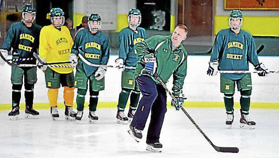 Hamden High's new hockey coach Todd Hall conducts practice at Astorino Rink in Hamden. Photo: Arnold Gold -- New Haven Register