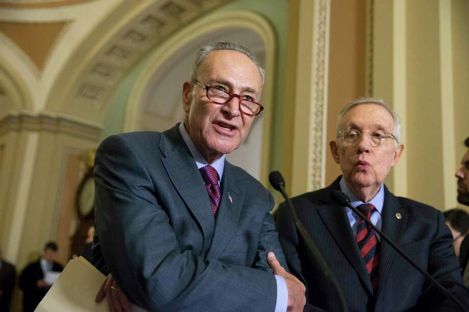 In this Dec. 8, 2015 photo, Sen. Chuck Schumer, D-N.Y., joined by Senate Minority Leader Harry Reid, D-Nev., right, criticizes Republicans for not doing enough to stop gun violence, during a news conference on Capitol Hill in Washington. Photo: AP Photo/J. Scott Applewhite, File   / AP