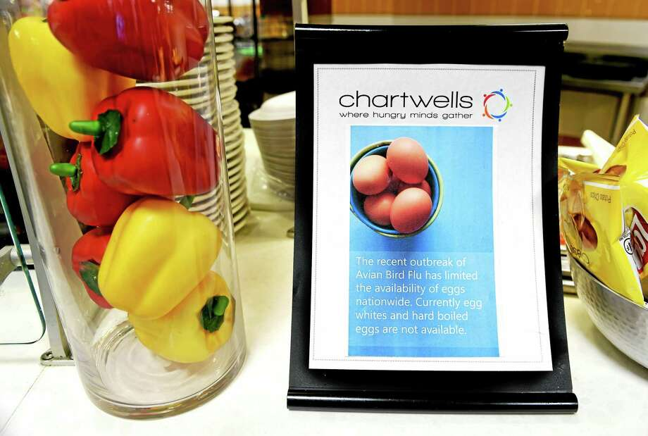 A Chartwells food service sign in the cafeteria at Quinnipiac University's North Haven Campus cafeteria. Chartwells, the Quinnipiac University food service, has cut back on serving eggs at breakfast because the Avian Flu outbreak has made them expensive and in short supply. Photo: (Peter Hvizdak — New Haven Register)   / ©2015 Peter Hvizdak