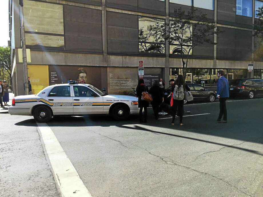 A pedestrian was hit by a New Haven police cruiser Tuesday afternoon on Chapel Street. Photo: Contributed Photo