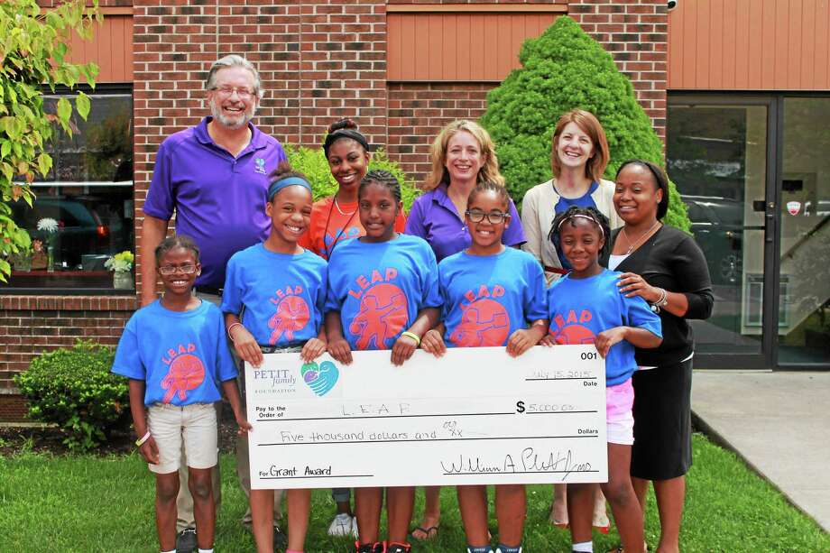 Dr. William Petit awards LEAP and its students $5,000 in grant funding. Photo: CONTRIBUTED PHOTO
