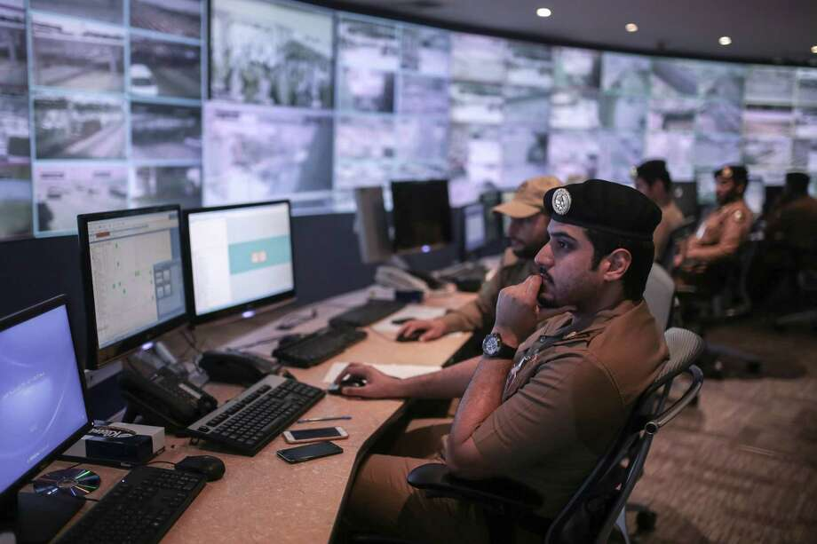 Saudi security officers monitor screens with live views of Muslim pilgrims in the holy city of Mecca, along with highways and high density areas, a few days before the start of the annual pilgrimage, known as the hajj, in Mecca, Saudi Arabia, Saturday, Sept. 19, 2015. Photo: (AP Photo/Mosa'ab Elshamy) / AP