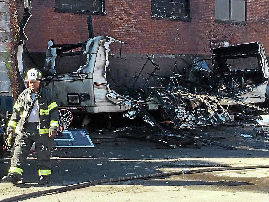 New Haven firefighters responded to Howard Avenue between Washington and Congress avenues where a camper-trailer had caught fire on Monday, Nov. 16, 2015. Photo: (Wes Duplantier -- New Haven Register)