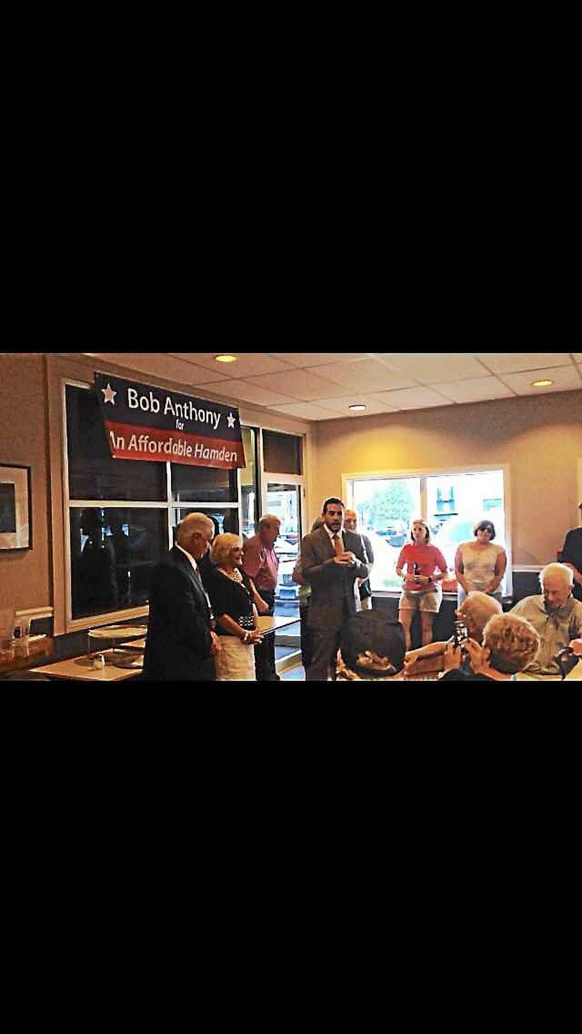 KATE RAMUNNI — NEW HAVEN REGISTER State Republican Chairman J. R. Romano, center, stumps for Bob Anthony, left, Monday.