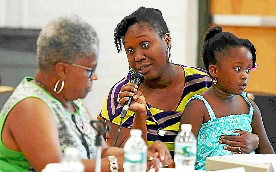 (Peter Hvizdak - New Haven Register) Congresswoman Rosa DeLauro and State Senator Marilyn Moore hosted a roundtable discussion with child care workers, administrators and parents Tuesday morning August 18, 2015 at the Sleeping Giant Day Care in Hamden calling for a nationwide $15 minimum full-time wage for child care workers. Photo: Peter Hvizdak -- New Haven Register  Congresswoman Rosa DeLauro And State Senator Marilyn Moore Ho