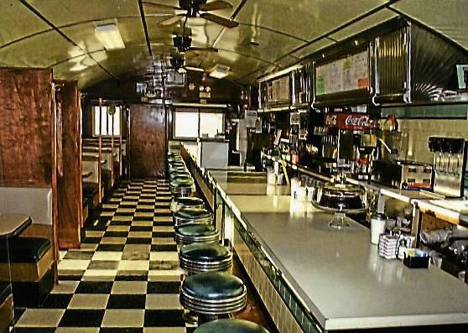 "The cover of ""Postcards from the Highway of Life"" shows the interior of the classic Peterborough Diner in New Hampshire. Photo: (Liz West)"