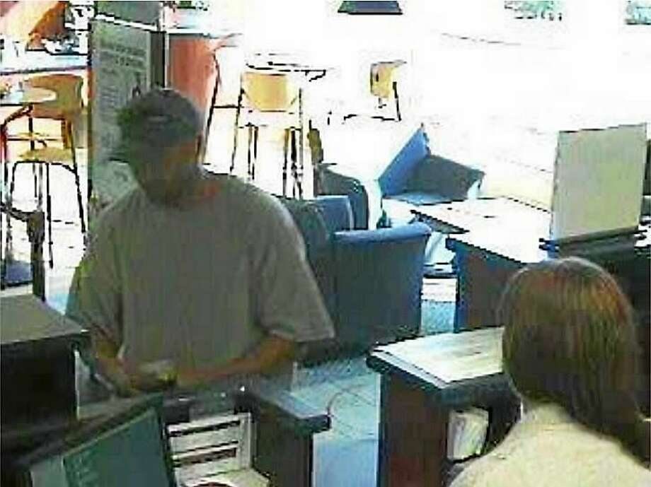 Milford police are investigating after a man robbed a People's United Bank branch Tuesday. The man allegedly claimed he had a weapon but did not show one. Photo: Photo Courtesy Of The Milford Police Department
