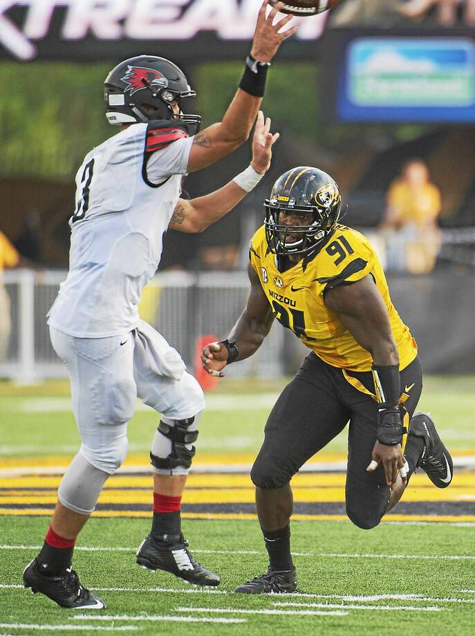 UConn's offense will have to deal with Charles Harris, right, and a the strong defensive front seven of Missouri on Saturday. Photo: The Associated Press File Photo   / FR23535 AP