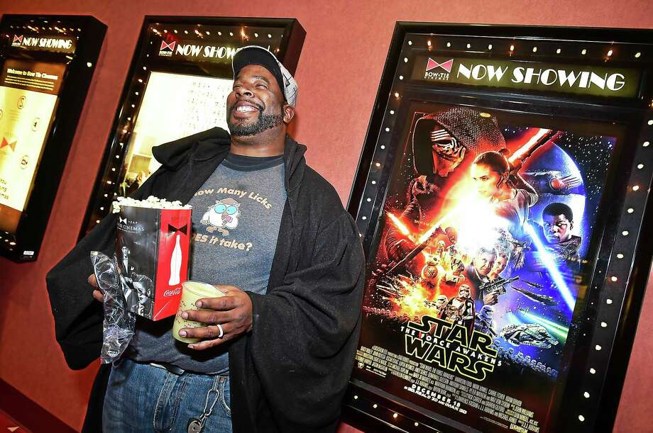 """Wearing a Vader-esque cape, Hugh Corley of New Haven was grinning from ear to ear Thursday at opening night of """"Star Wars: The Force Awakens"""" at the Bow Tie Criterion Cinemas on Temple Street in New Haven. """"I've been waiting a long time for this, ever since I heard they were making a new movie,"""" Corley said. """"I was afraid it wasn't going to happen."""" Photo: Catherine Avalone — New Haven Register      / New Haven RegisterThe Middletown Press"""