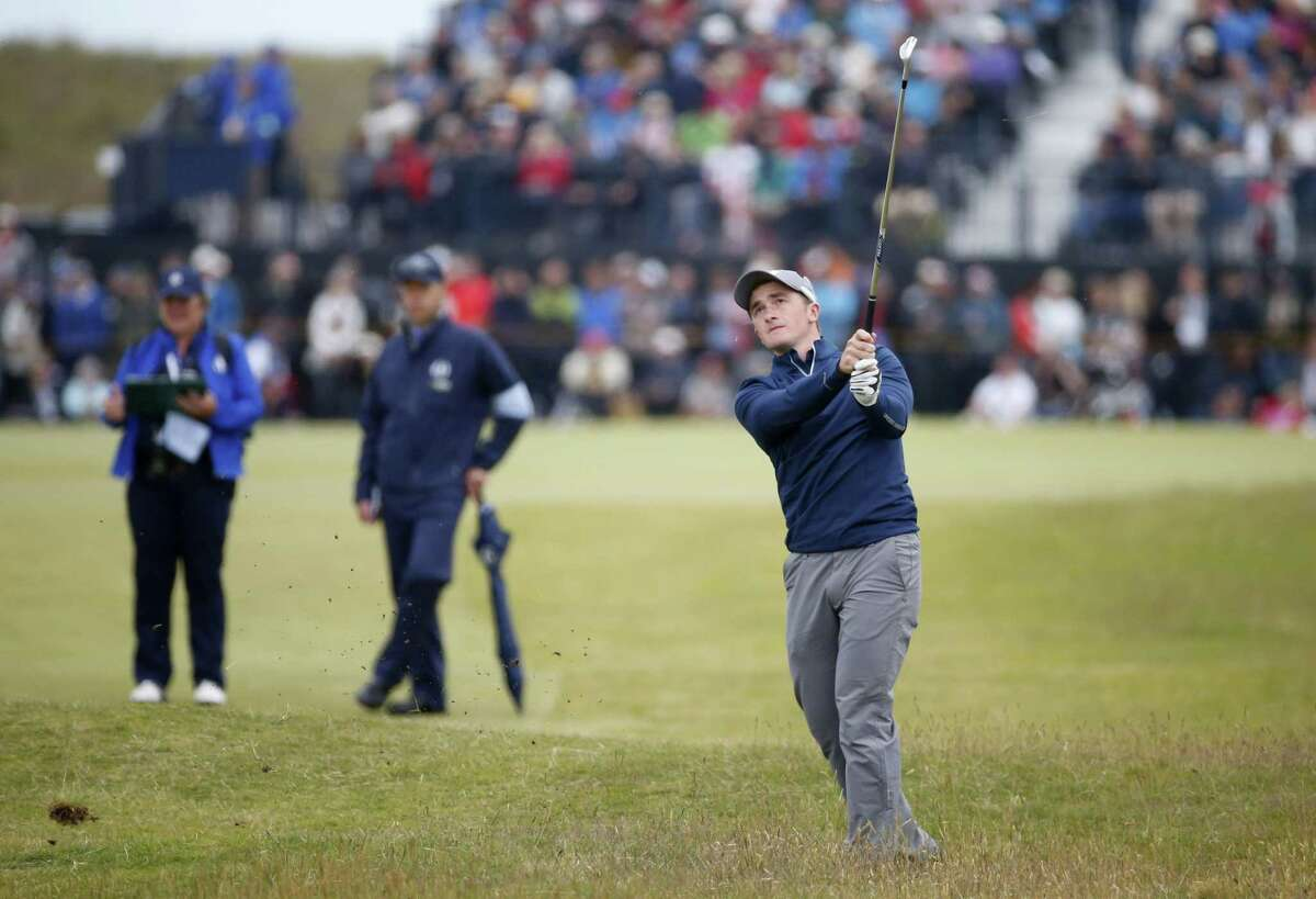 Ireland's Paul Dunne plays his second shot on the 10th hole during the third round of the British Open on Sunday.