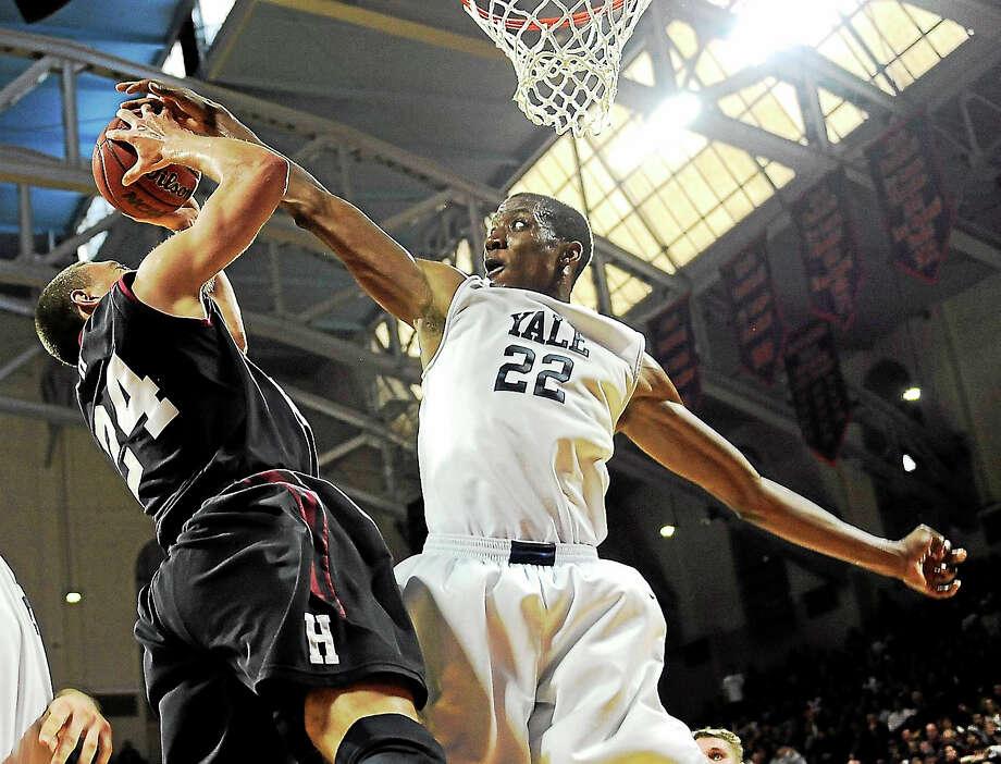 Yale's Justin Sears (22) blocks a shot from Harvard's Jonah Travis last March in Philadelphia. Photo: The Associated Press File Photo   / FR168006 AP