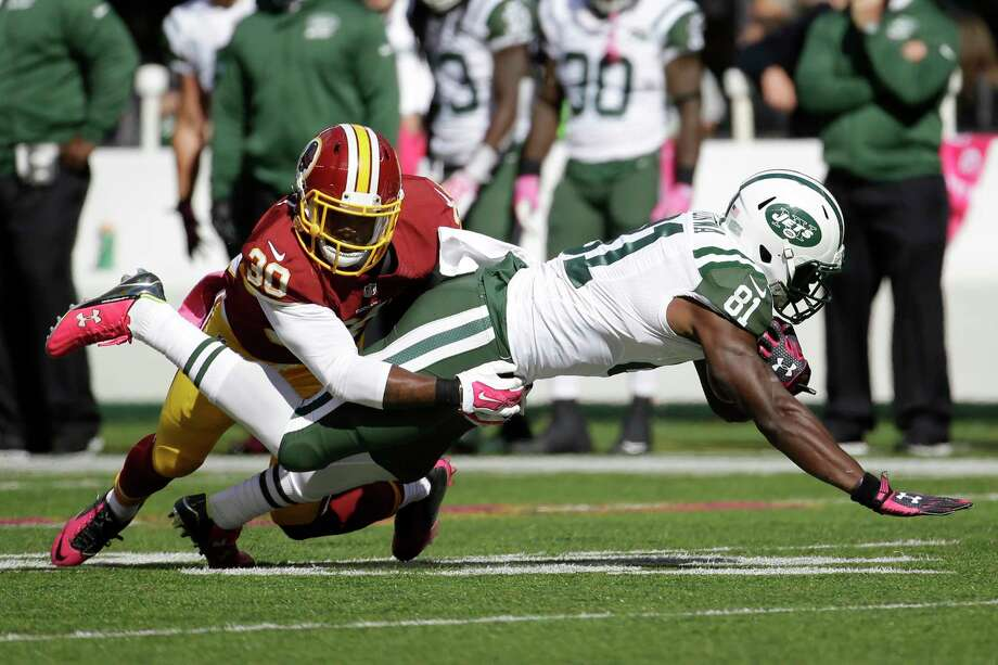 New York Jets wide receiver Quincy Enunwa (81) is tackled by Washington Redskins strong safety Kyshoen Jarrett (30) during the first half of an NFL football game, Sunday, Oct. 18, 2015, in East Rutherford, N.J. (AP Photo/Seth Wenig) Photo: AP / AP