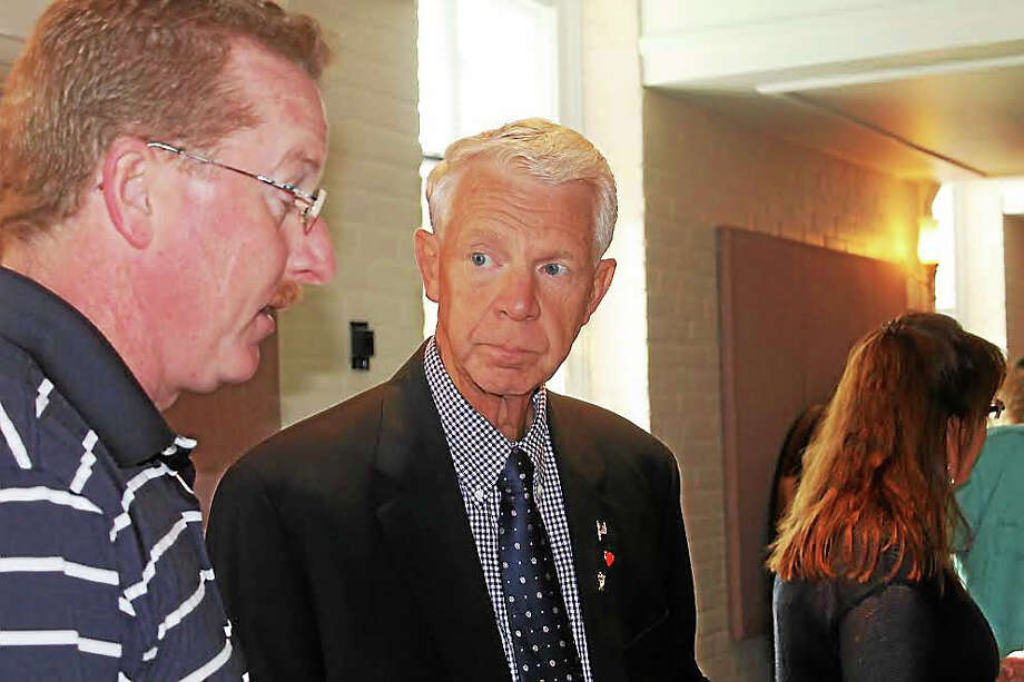 VALERIE BANNISTER PHOTO  Clinton Republican First Selectman candidate Bruce Farmer talks with Republican Town Committee Vice Chairman James Staunton during the recounting of votes Nov. 7. Photo: Journal Register Co.