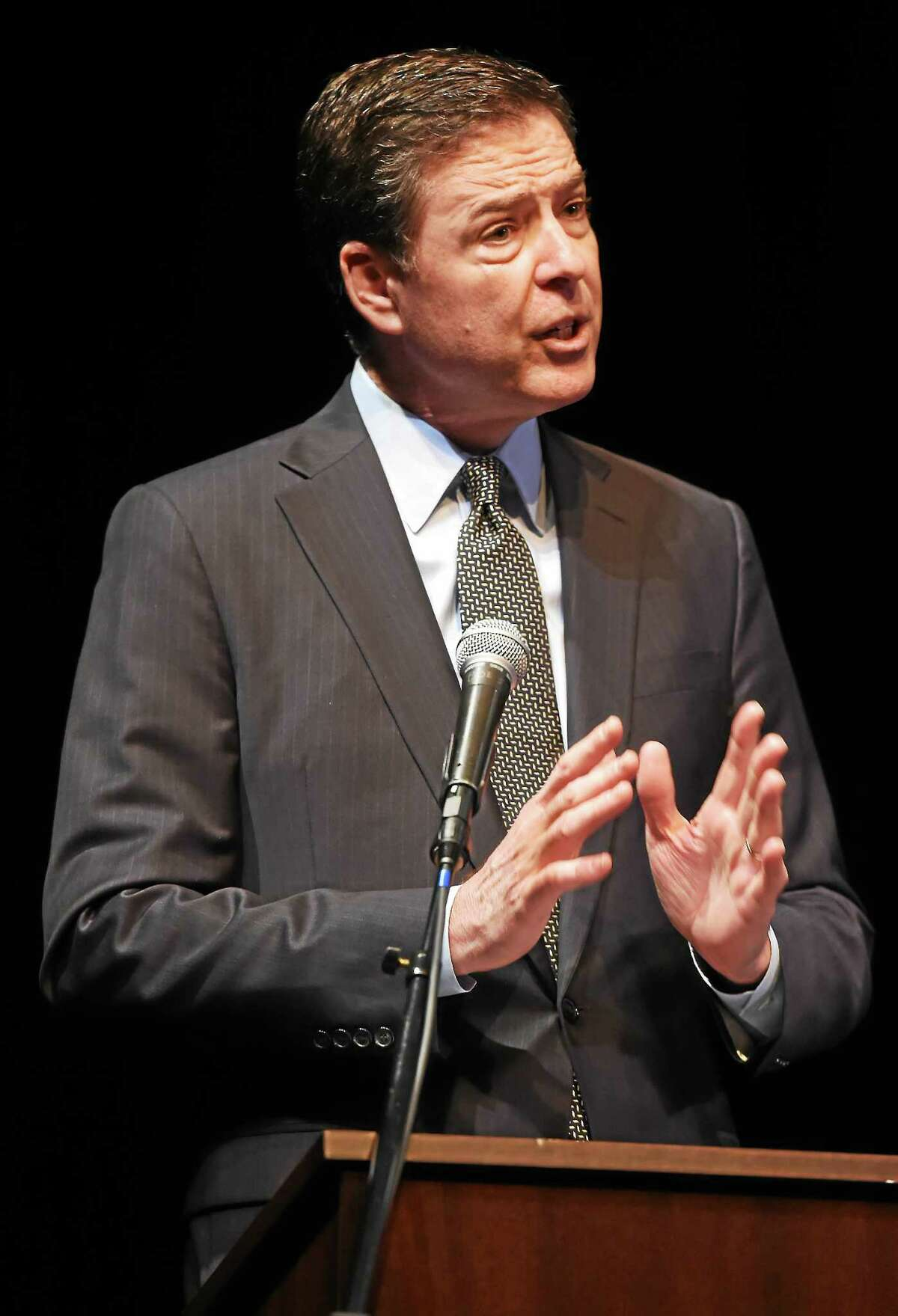 FBI Director James Comey gives the closing address during the Building Bridges Conference at Cooperative Arts and Humanities High School in New Haven Monday.