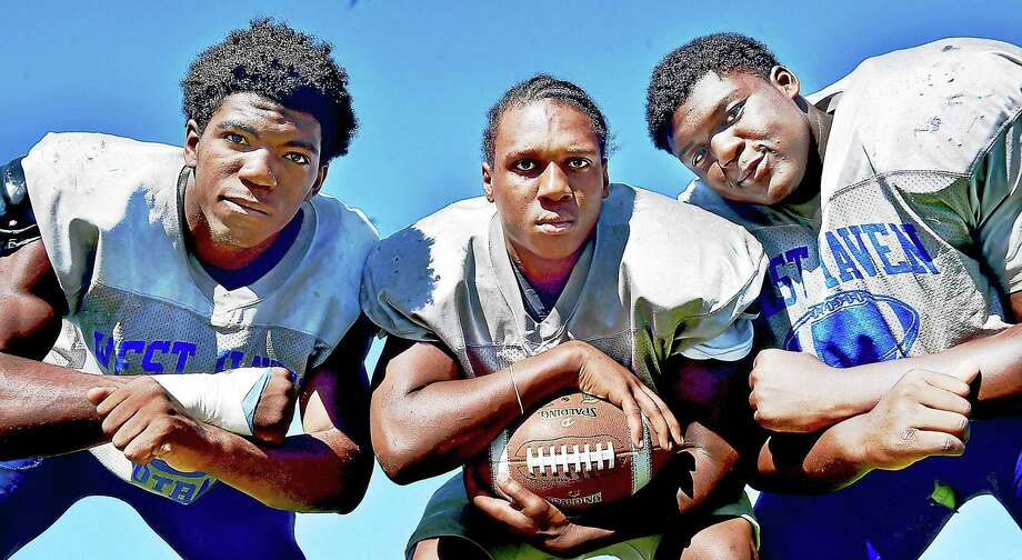 West Haven football captains, left to right, defensive end Marquis Lockhart, middle linebacker Adrian Jaynes and defensive tackle Byron Dickens. Photo: Catherine Avalone — New Haven Register / New Haven RegisterThe Middletown Press