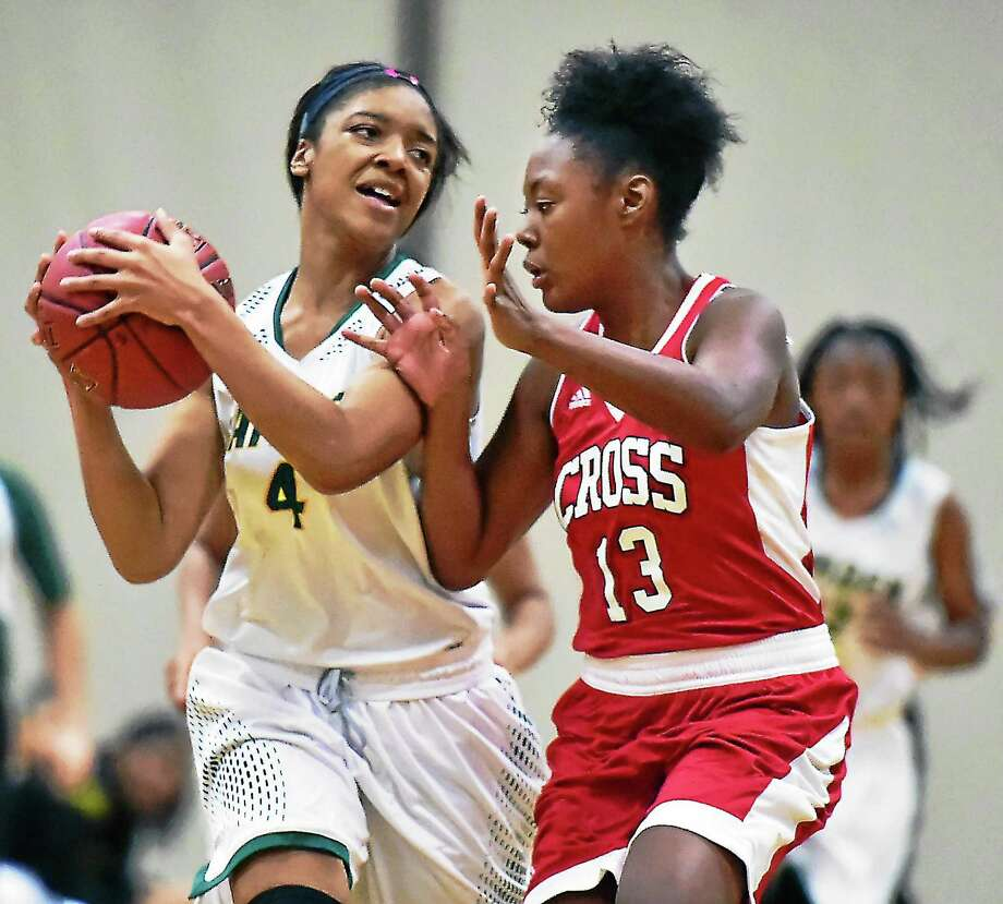 Hamden senior guard and captain Jessica Davis drives midcourt as Wilbur Cross' Anaija Ricks (13) defends in a 55-45 win for the Dragons in the season opener Tuesday at Hamden High School. Photo: Catherine Avalone -- New Haven Register   / Catherine Avalone/New Haven Register