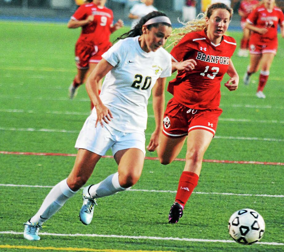 East Haven's Megan Kikosicki, here against Branford's Wyntre Fries in the first matchup between the two teams last month, has scored 22 goals this season. Photo: Dave Phillips/GameTimeCT