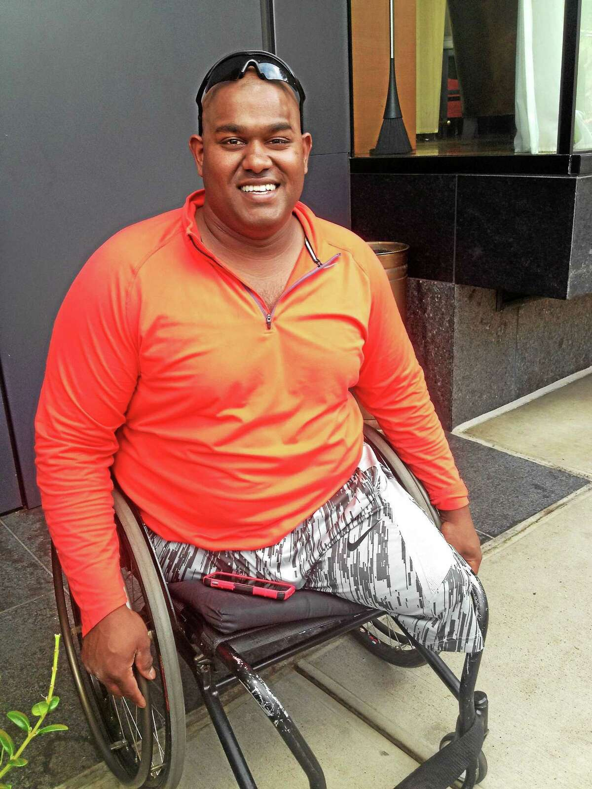 Toran Gaal, who lost both his legs and came close to death when an IED exploded while he was serving in Afghanistan, outside the Study at Yale hotel on Sunday, July 19, 2015 in New Haven.