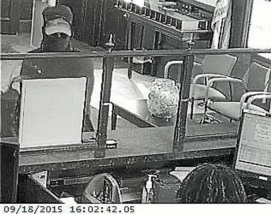 Police are looking for this man who they say robbed the Citizens Bank on Boston Post Road in Orange of an undetermined amount of money Friday. Photo: Orange Police Department